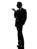 Effeminate snobbish business man silhouette. One caucasian effeminate snobbish business man in silhouette on white background royalty free stock photo
