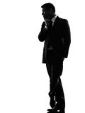 Effeminate snobbish business man silhouette. One caucasian effeminate snobbish business man in silhouette on white background royalty free stock images