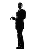 Effeminate snobbish business man silhouette. One caucasian effeminate snobbish business man in silhouette on white background stock image