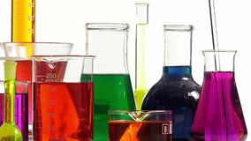 Effervescence in several bottles of various colors. Several laboratory bottles of different shapes and colors stock video
