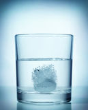 Effervescent dissolving fizzy tablet in water Stock Photography
