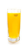 Effervescent orange tablet in glass of water Stock Photo