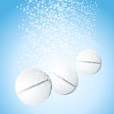 Effervescent pills. Effervescent tablets with bubbles in blue water Stock Photo