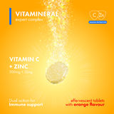 Effervescent soluble tablet pills packaging. Effervescent soluble tablet pills. Vitamin C plus Zinc soluble pills with orange flavour in water with sparkling Royalty Free Stock Images