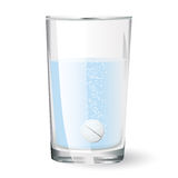 Effervescent tablet in glass. Of water Royalty Free Stock Image