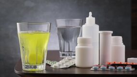 Effervescent tablet vitamin C fall and dissolves in glass with water. Prevention arvi or flu