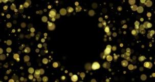 Effet léger de bokeh d'or avec les particules et la lumière d'or de miroiter bouclé banque de vidéos
