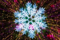Effetti della luce astratti dei fiocchi di neve Fotografie Stock