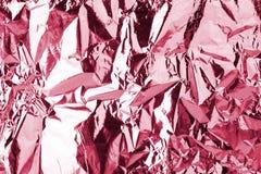 Effetto sgualcito metallico brillante rosa-chiaro di struttura, fondo serico molle corrugato rosso, contesto lucido porpora di ar immagine stock