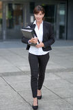 Efficient businesswoman approaching the camera Royalty Free Stock Photo