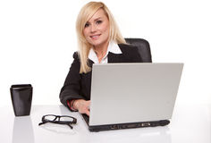 Efficient businesswoman working on her laptop Stock Photo