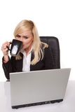 Efficient businesswoman working on her laptop Stock Image