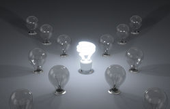 Efficient energy. New ideas. A lit up compact fluorescent light bulb Royalty Free Stock Photo