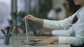 Efficient office employee finishes typing and shutting down laptop, project done. Stock footage stock video
