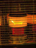 Efficient space heater. Room heaters, open fire behind metal bars Royalty Free Stock Image