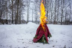 The effigy is lit on Shrove Tuesday in Russia royalty free stock photography