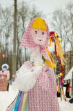 The Effigy Of Maslenitsa. Bright doll in Russian national clothes. Winter royalty free stock photos