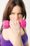 Effort. Exercising with effort grimace on the face royalty free stock image