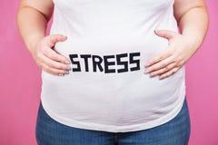 Effort, boulimie, manger avec excès compulsif, de poids excessif image stock