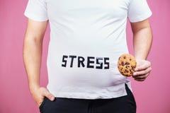Effort, boulimie, manger avec excès compulsif, gain de poids images libres de droits