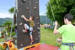 Effort of a boy in climbing a wall Royalty Free Stock Photos