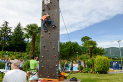 Effort of a boy in climbing a wall Royalty Free Stock Image