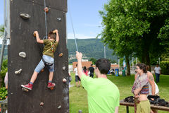 Effort of a boy in climbing a wall Stock Image