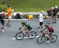 Effort. Col de Peyresourde,France- July 23, 2014: The cyclists Yukiya Arashiro (Europcar Team) and Peter Velits (BMCTeam) climbing the road to Col de Peyresourde Royalty Free Stock Photography