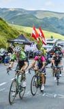 Effort. Col de Peyresourde,France- July 23, 2014: Group of cyclists lead by Bauke Mollema (BelkinTeam), Kristijan Durasek (Lampre Merida Team) and David Lopez Stock Photography