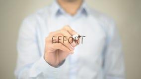 Effort, Man writing on transparent screen Stock Photography