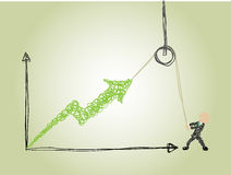 An effort to make business grow. A business man use a hoist to lift an arrow indicating business grow Stock Photo