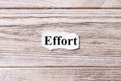 Effort of the word on paper. concept. Words of Effort on a wooden background Stock Photo