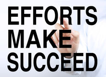 Efforts Make Succeed. Businessman is pointing the text Efforts Make Succeed on the virtual transparent screen Stock Image