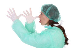 Effrontery engraçado do gesto do trabalhador dos cuidados médicos Foto de Stock
