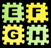 EFGH Alphabet learning blocks isolated Black Royalty Free Stock Photos