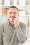 EFT tapping points. Man doing EFT on the under eye point. Emotional Freedom Techniques, tapping, a form of counseling intervention that draws on various theories Royalty Free Stock Photos