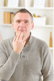 EFT tapping points. Man doing EFT on the under lip point. Emotional Freedom Techniques, tapping, a form of counseling intervention that draws on various theories Royalty Free Stock Image