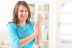 EFT tapping points. Woman doing EFT on the karate chop point. Emotional Freedom Techniques, tapping, a form of counseling intervention that draws on various Royalty Free Stock Image