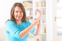 EFT tapping points. Woman doing EFT on the karate chop point. Emotional Freedom Techniques, tapping, a form of counseling intervention that draws on various Stock Photography