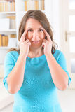 EFT tapping points. Woman doing EFT on the side of eye point. Emotional Freedom Techniques, tapping, a form of counseling intervention that draws on various Royalty Free Stock Photo