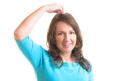 EFT tapping points. Woman doing EFT on the top head point. Emotional Freedom Techniques, tapping, a form of counseling intervention that draws on various Royalty Free Stock Image