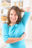 EFT tapping points. Woman doing EFT on the under arm point. Emotional Freedom Techniques, tapping, a form of counseling intervention that draws on various Royalty Free Stock Photos