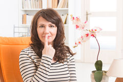 EFT tapping points. Woman doing EFT on the under nose point. Emotional Freedom Techniques, tapping, a form of counseling intervention that draws on various Royalty Free Stock Photography