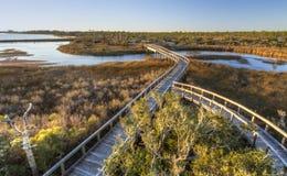 Eftermiddagsol på stor lagunstrandpromenad arkivbilder