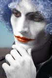 Eftertänksam clown utomhus royaltyfri bild