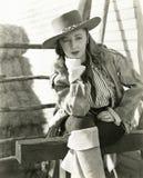 Eftertänksam cowgirl Royaltyfri Bild