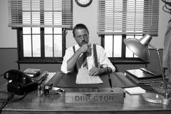 Eftertänksam direktör som arbetar på skrivbordet Royaltyfri Fotografi