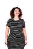 Eftertänksam härlig curvy flicka med den randiga klänningen Fotografering för Bildbyråer