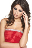 Eftertänksam härlig kvinna i röd klänning Royaltyfria Foton