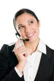 eftertänksam kvinna för affärshörlurar med mikrofon Arkivbild